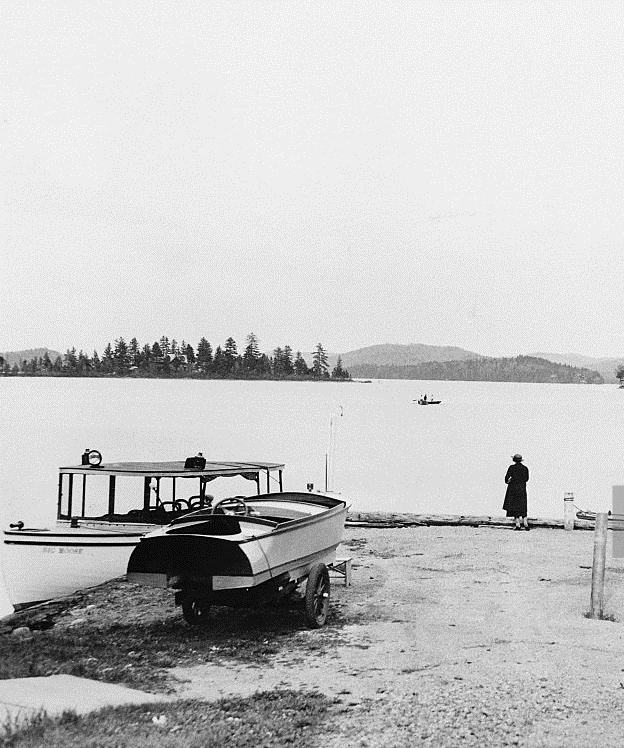 Boats docked at Big Moose Lake where Chester Gillette murdered Grace Brown. One of the tales of our haunted Adirondacks.