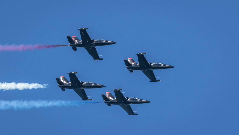 Patriots flight team in delta formation.jpg
