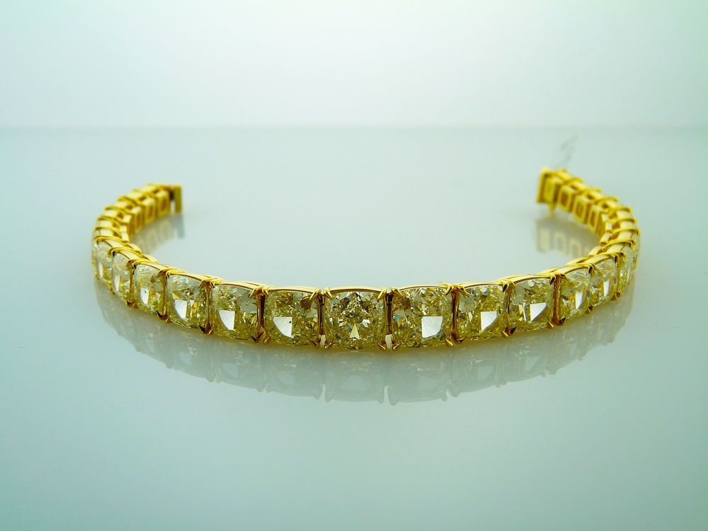 Natural Fancy Yellow Cushion Cut diamond tennis bracelet set in yellow gold