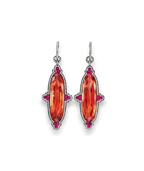 The most important known piece of jewelry are these gorgeous Ellen Birkin's Imperial Topaz earrings by JAR sold at Christie's auction for $ 650,000