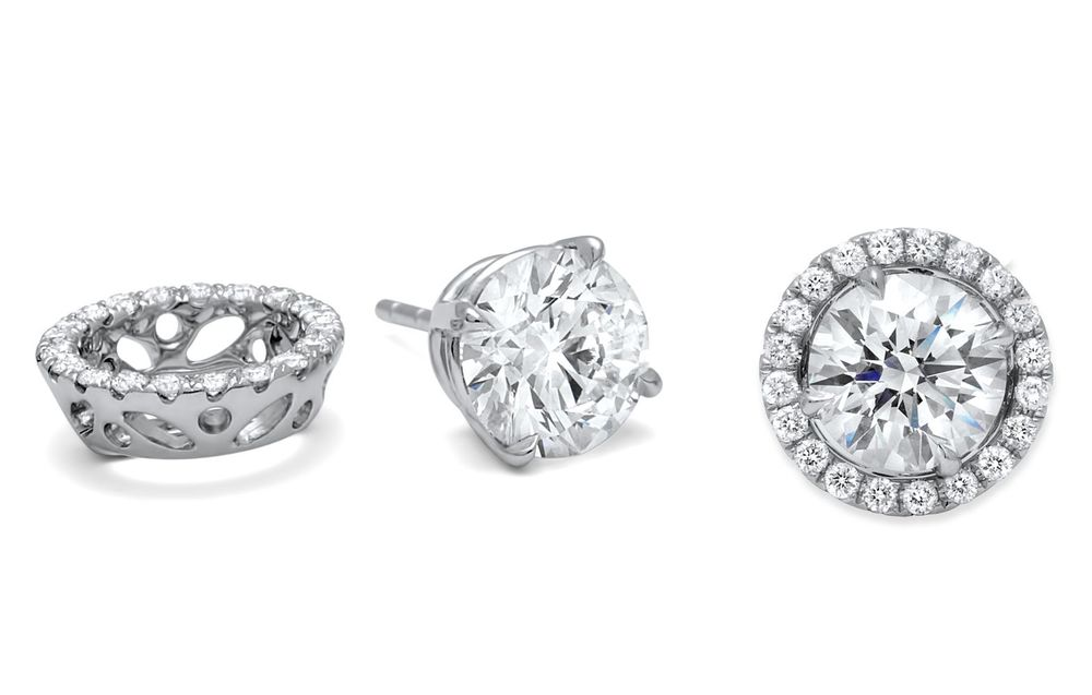"Diamond Studs with removable halo diamond ""jackets"", in 18K WG.  Price: from $ 1,800, various diamond sizes are available."