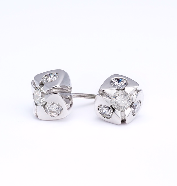 One of a kind, 18K White Gold custom made diamond studs.  Price: $ 1,250.00