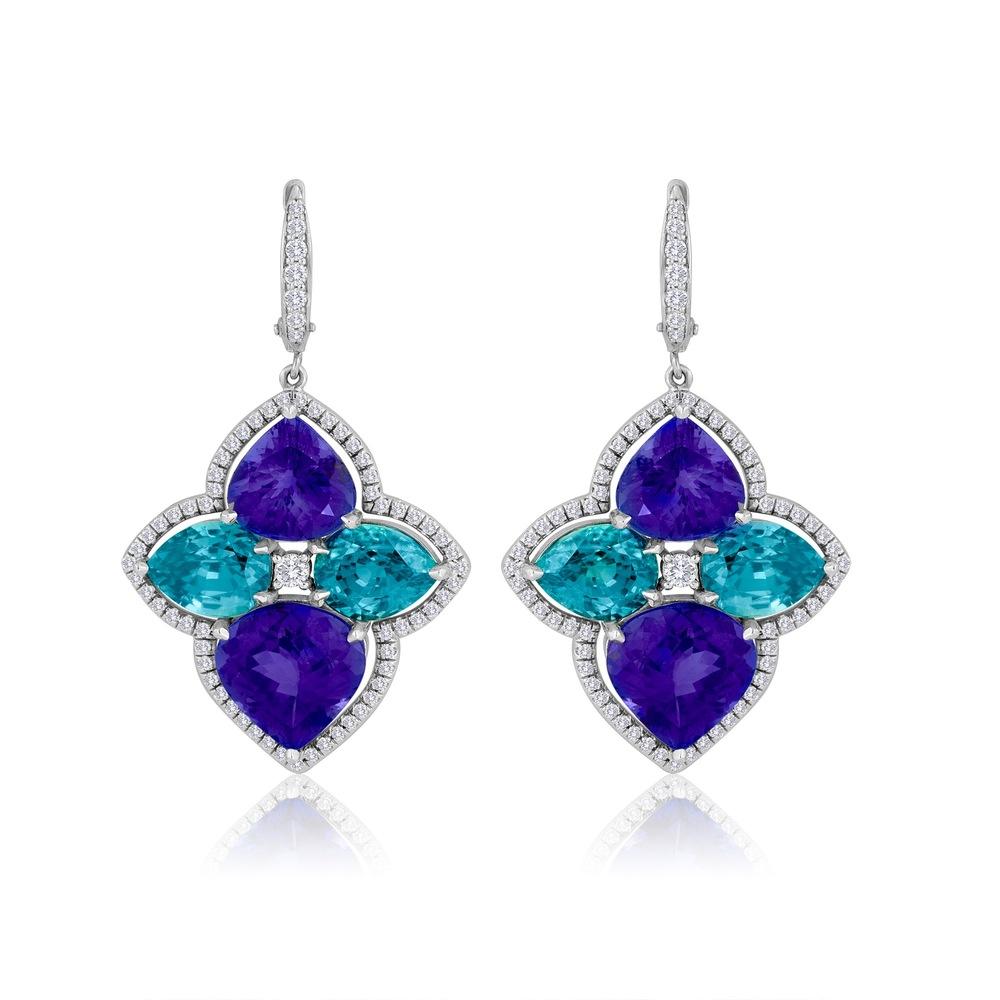 Tanzanite TW 19.53 CT's Blue Zircon TW 16.30 CT's 138 Diamonds TW 1.07 CT's Please inquire about price.