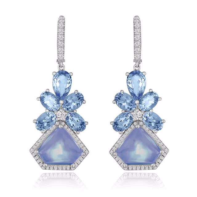 Aquamarines TW 4.93 CT's Moonstones TW 8.93 CT's Diamonds TW 56 CT's Please inquire about price.