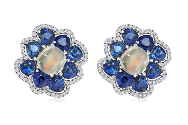 Moonstones TW 7.40 CT's Sapphires TW 13.28 CT's 117 diamonds TW 0.63 CT's Please inquire about price.