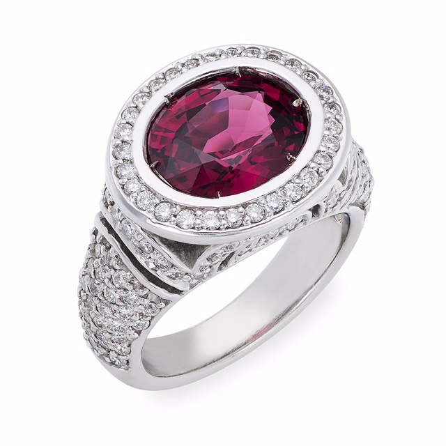One of a kind 18K White gold diamond ring with beautiful and rare Oval Shaped Spinel over 5 carats.  Price $ 3,970.00