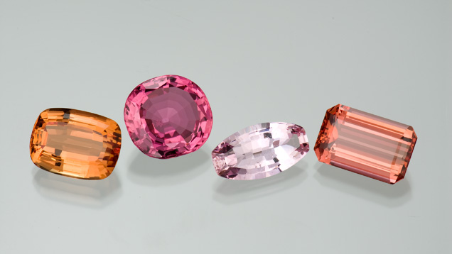 This selection of gems from Ouro Prêto, Brazil, and Russia's Ural Mountains, displays the golden orange to pinkish red color range of precious topaz. The gems range from 7.61 to 14.33 carats in size.