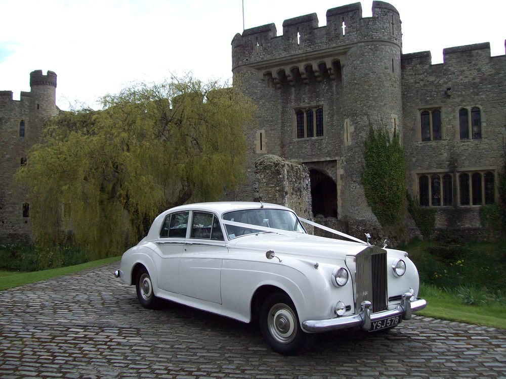 White Rolls Royce Silver Cloud pictured at Allington Castle wedding.