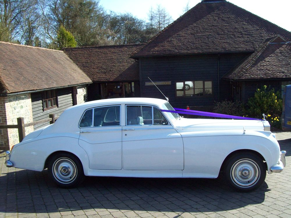 White Rolls Royce wedding car is a popular choice.