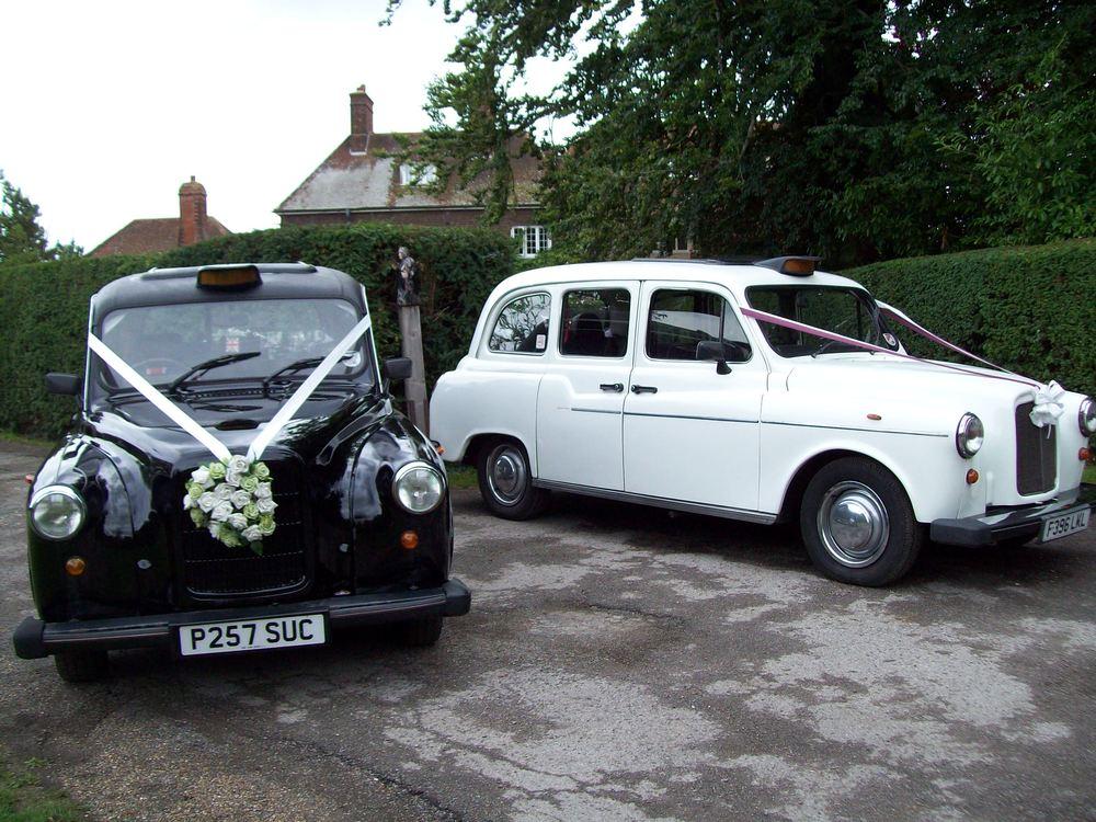 black taxi & white taxi.JPG