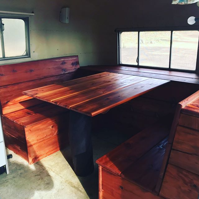 Custom Redwood breakfast nook I just finished in my bud's 1954 Airstream. All the Redwood came from his property including an old-growth root that I used as the front post. Pretty stoked on how this turned out. #woodwork #airstreamremodel