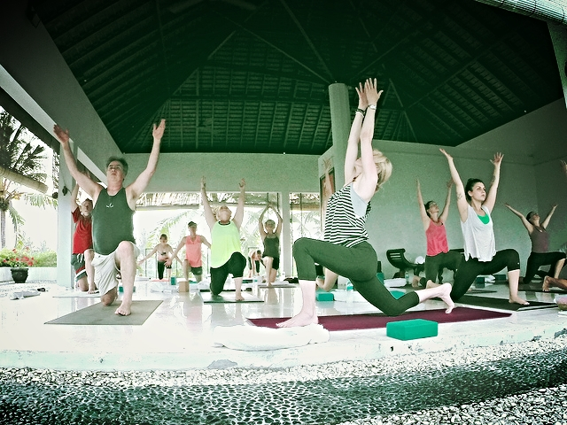 Yoga moms in Bali by Fabrice Florin
