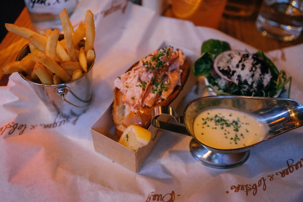 Classic lobster roll with a side of fries and truffle mayo! Get the story of Stockholm's most delicious eats and travel stories at www.MadeinMoments.com