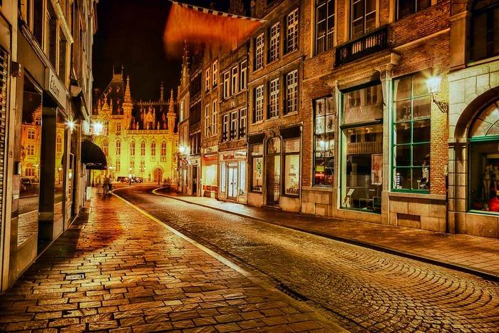 Cobbled street in Brugge, Belgium at night after a summer rain shower