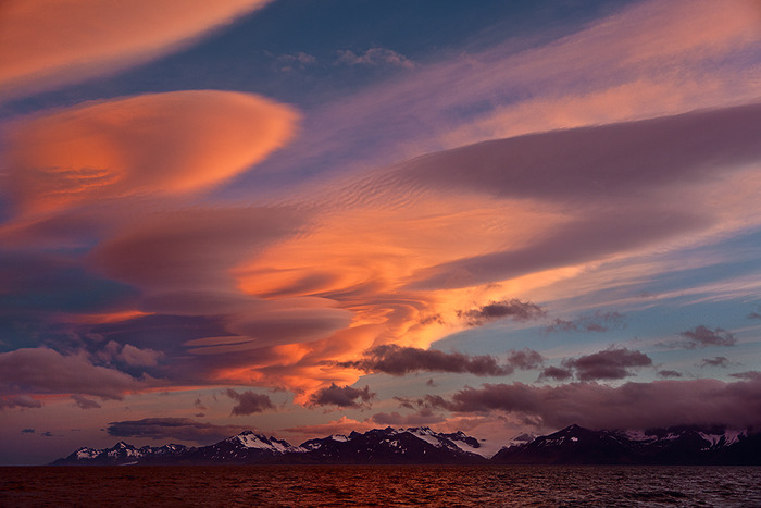 Huge clouds photographed from a helicopter at sunset near Ushuaia, Argentina