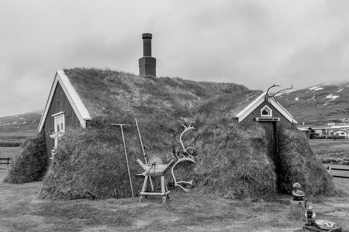 Black and white photo of a lovely historic cottage n rural Iceland