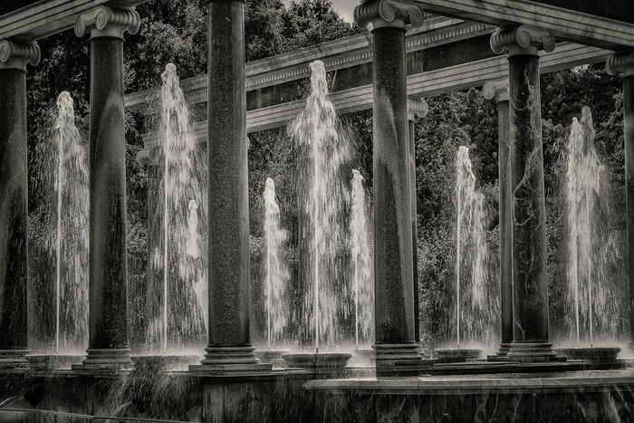 A black in white photo of beautiful fountains in a quiet area of the glorious Peterhof Summer Palace near St. Petersburg, Russia