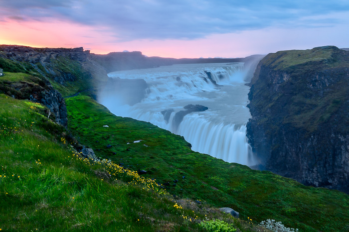 Beautiful gentle light shows the lush surrounds and power of the magnificent Gullfoss Waterfall, Iceland