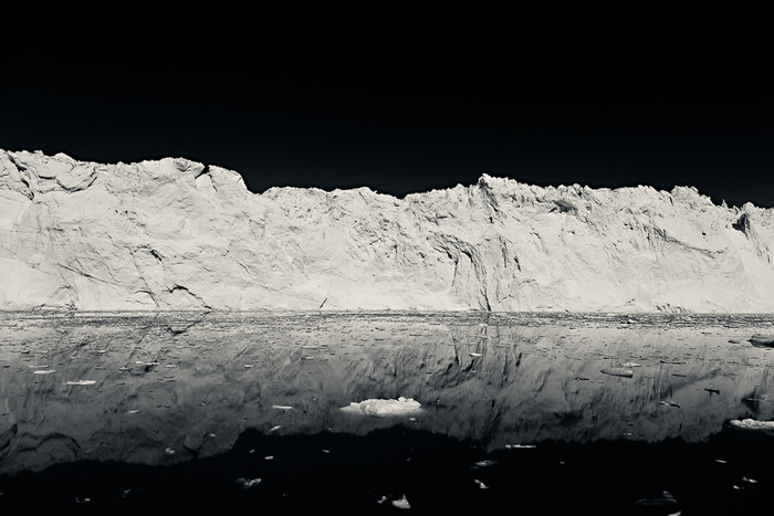Black and white photo of a huge iceberg on the Ilulissat Icefjord, Western Greenland