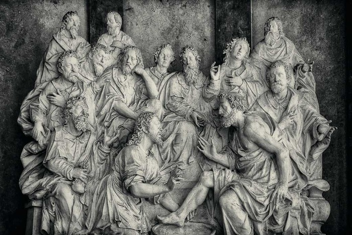 Beautiful light illuminates this statue of a group of luminaries at the Cemetery of St. Sebastian in Salzburg, Austria.
