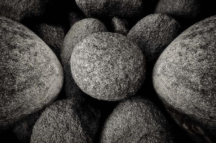 Black and white photo exploring balance and harmony of rocks at Cape Woolamai, Phillip Island, Australia