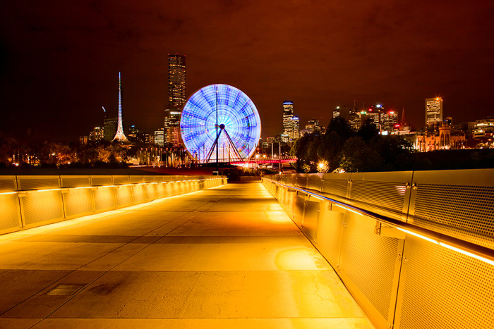 Ferris wheel and city skyline at night, Melbourne