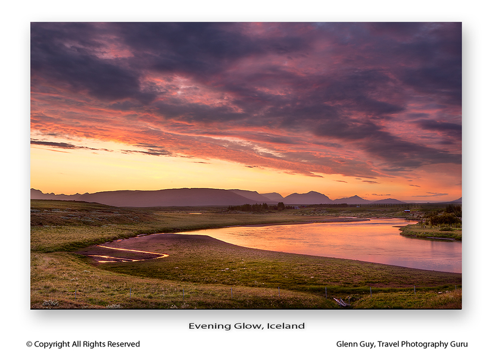 Beautiful landscape featuring sky, river and distant mountains photographed at sunset, Iceland
