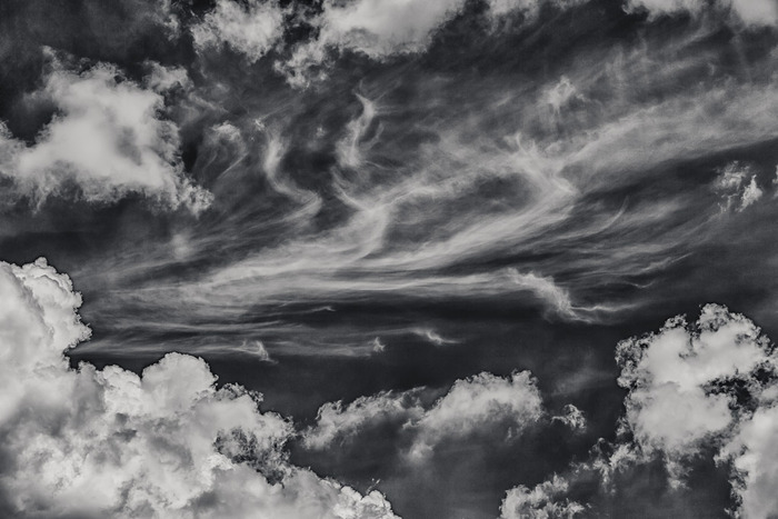 Dramatic black and white image of clouds against a near black sky