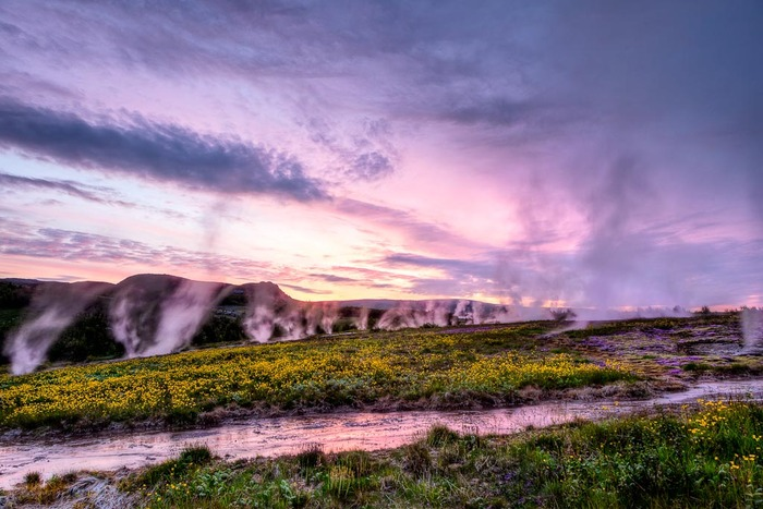 Geysers and creek at sunset, Iceland