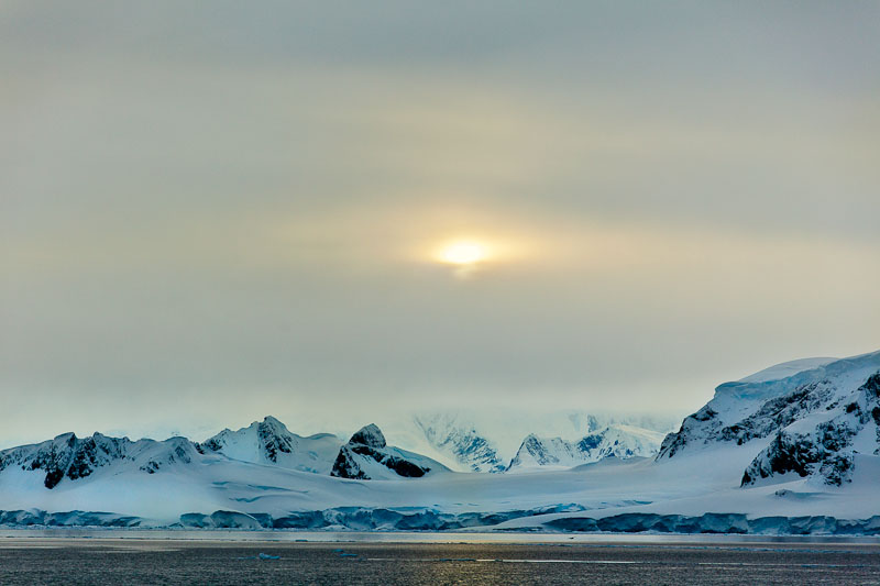 Covered in snow and ice Cuverville Island is a rugged outcrop in the Antarctic Peninsula