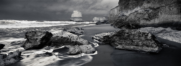 panoramic black and white photo of approaching storm on the beach at Gibson Steps, Great Ocean Road, Australia