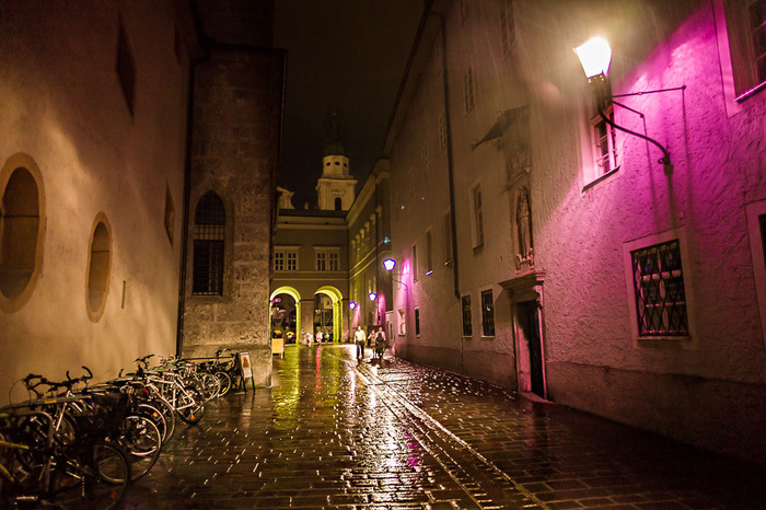 Wet cobbled streets in the old quarter of Salzburg, Austria makes for an atmospheric adventure