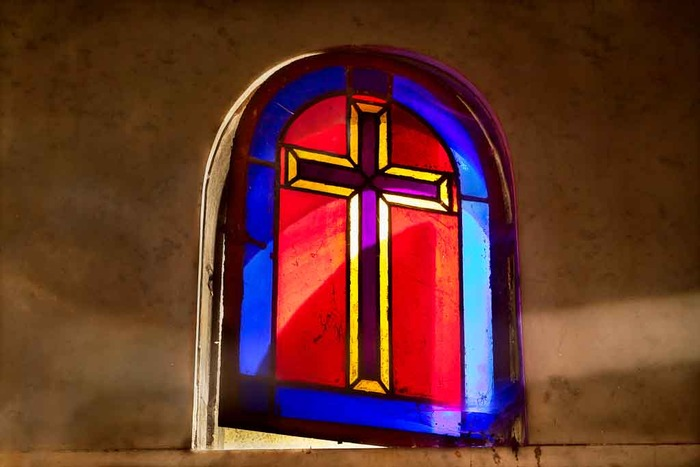 light passing through stainglass window in a chapel adjoining the spectacular Sacre Coeur Basilica in Paris, France