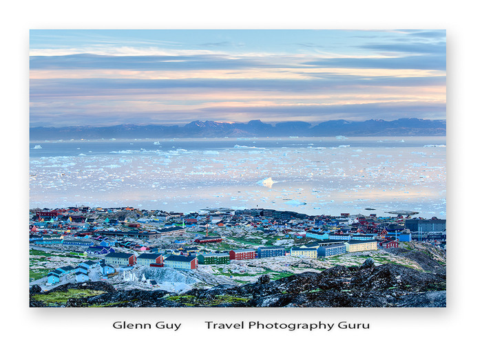 Looking from above onto the town of Ilulissat, Greenland and beyond to the Ilulissat Icefjord