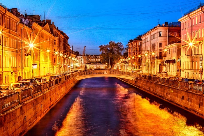 Night photo of buildings either side of canal in St. Petersburg, Russia