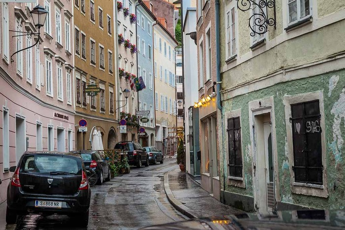 A day of rain provides great opportunities for photography, as is the case with this street scene in the old part of Salzburg, Austria