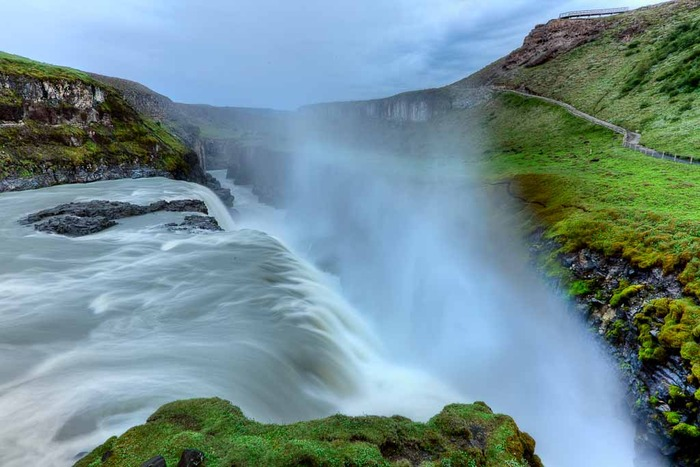 cascading waterfall showing nature's power at Gullfoss in Iceland
