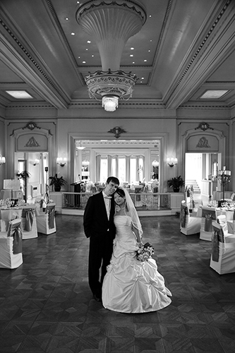 Bride and groom, full length at reception centre