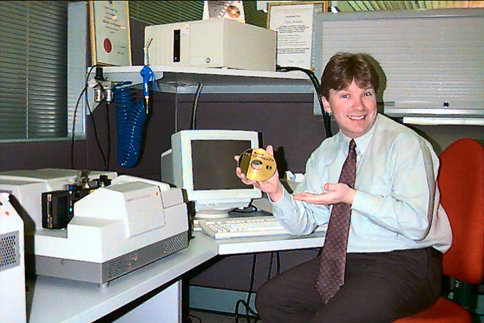 Photo of Glenn Guy, the Travel Photography Guru, at the Kodak Photo CD Workstation at Coburg, Australia around 1995
