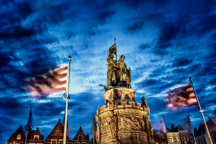 statue and night sky, city square, Brugge, Belgium