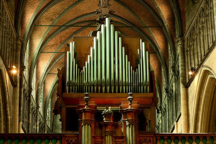 Organ pipes within church interior Bruges, Belgium