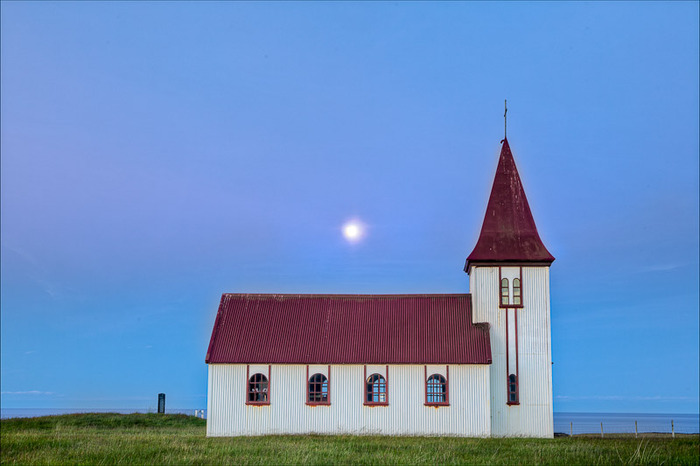 A seaside church in rural Iceland on a lovely summer's evening