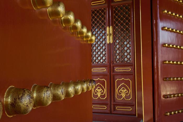 Huge partly open doorway at The Forbidden City in Beijing, China
