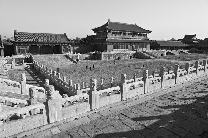 Black and White photograph of large courtyard and architecture at the Forbidden City in Beijing, China