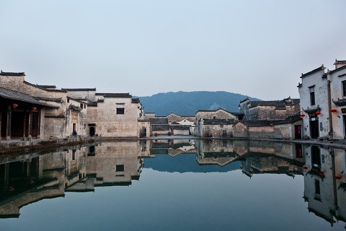 Beautiful image of buildings relected in pond at Hongcun, a classic village in China