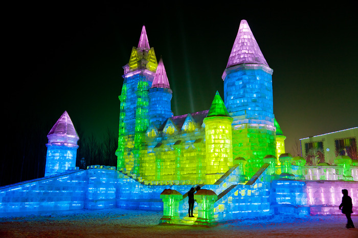 Large scale scultpure, illuminated by night in neon, at Iceworld in Harbin, China