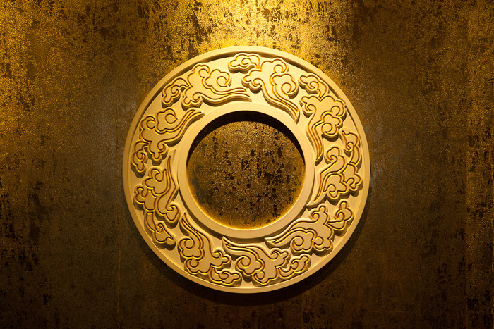 A yellow disc shaped wall feature at the Summer Palace, Beijing