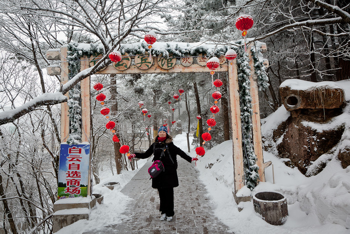 Young Woman and red decorations along pathway on Huangshan or Yellow Mountain in China