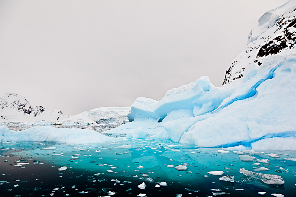 The surreal aqua color of ice and water associated with Antarctic