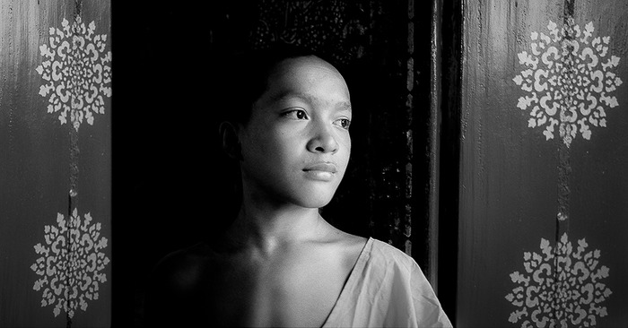 A dramatic portrait of a buddhist monk in luang prabang, laos